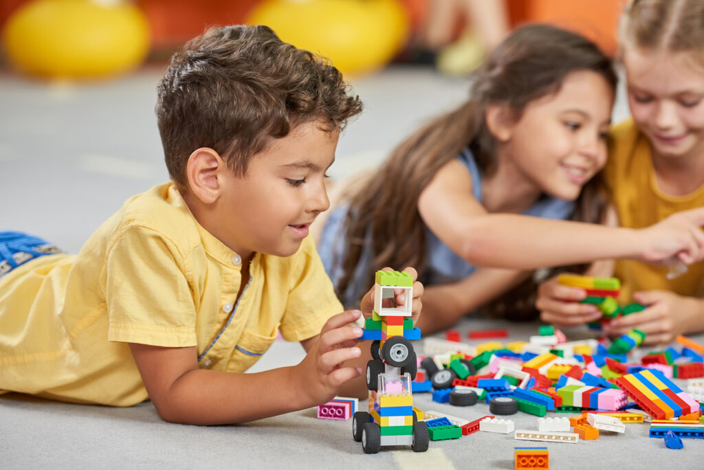 Kids playing block toys in their playroom.