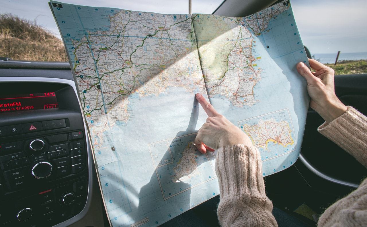 Person travelling with a map