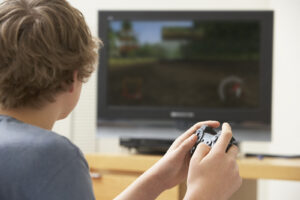 Teenage boy playing some video game