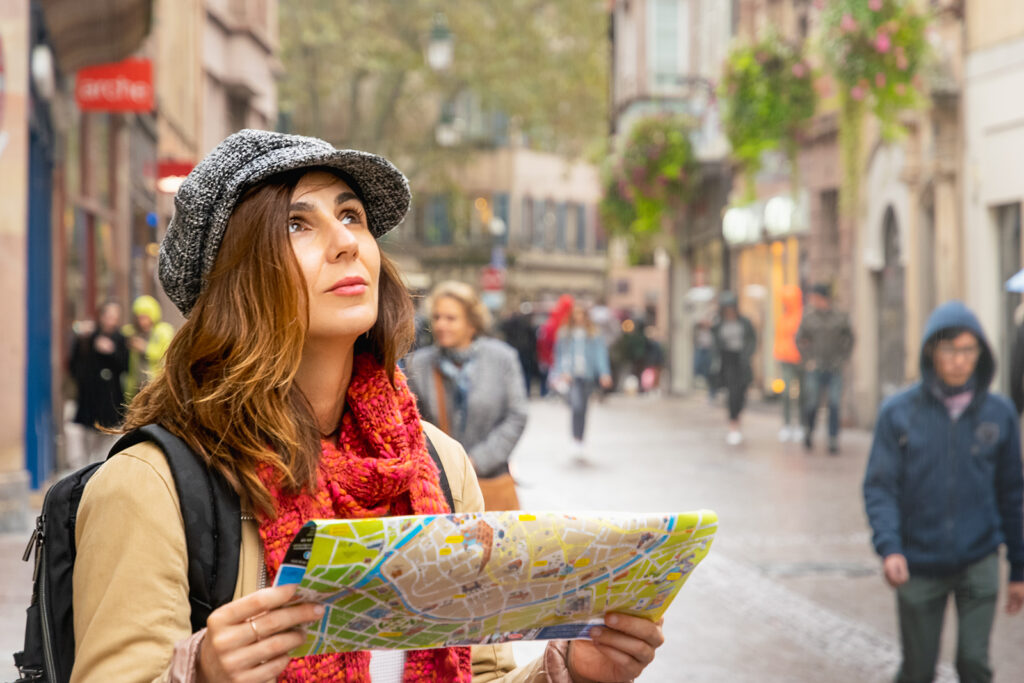 Woman traveler in vacation looking at a map.