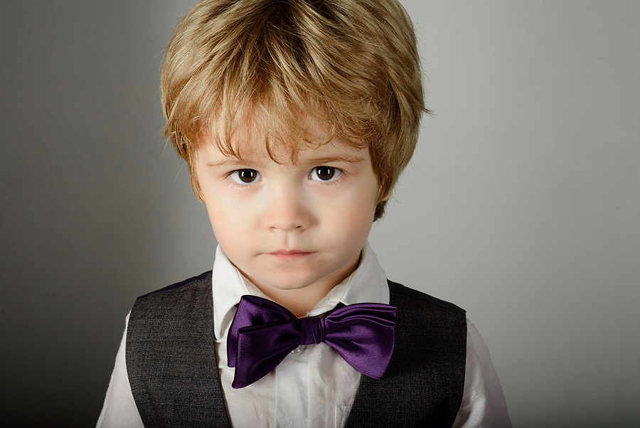 Fashionable little boy in stylish clothes & bow tie.