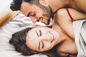 Happy romantic couple having sex.