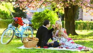 Loving couple having a romantic picnic date.