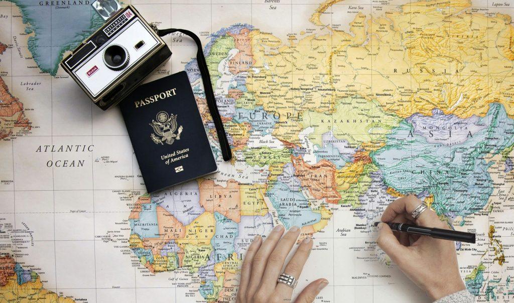 Camera, passport and a map