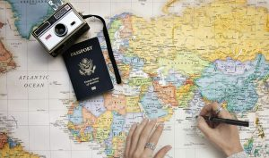 Camera, passport and a map