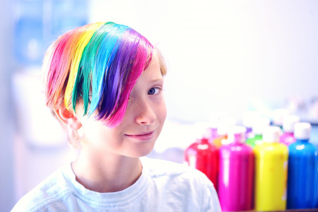 Young boy with different hair color
