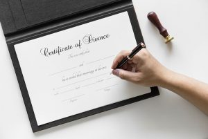 Hand signing a certificate of divorce