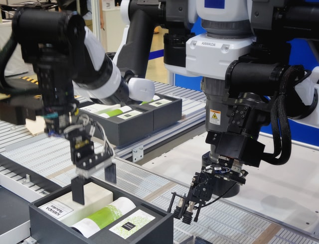 An AI robot packing products and advancing technology.