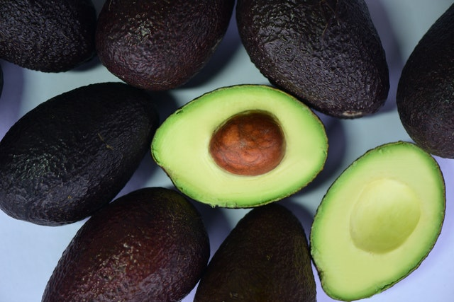 A bunch of avocados halved as food for eating for weight loss.