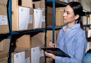 Businesswoman working with product inventory for reverse logistics