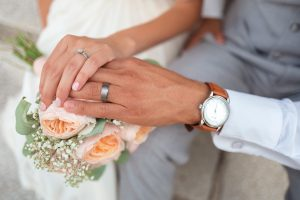 Bride and groom's hands wearing their wedding ring