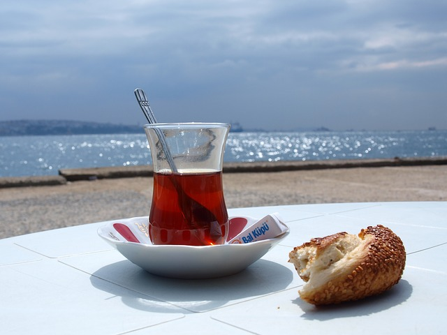 Simit food to try and tea in Istanbul on a table.