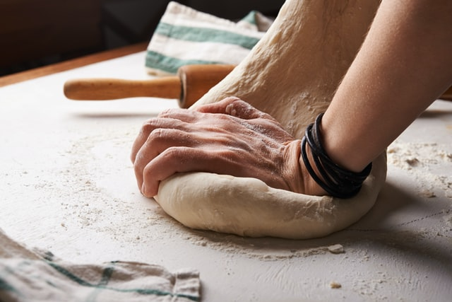 Someone kneading a good bread option for health.
