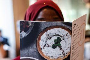 Woman looking at a restaurant menu