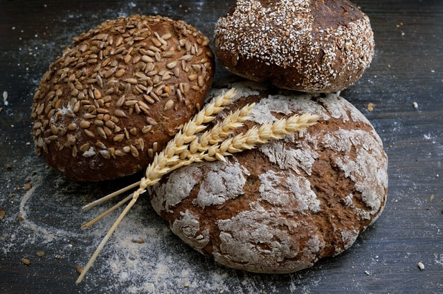 Three loaves of wholegrain bread that aren't as bad for your health as other types.