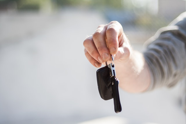 Someone holding out car keys after choosing best vehicle for you.
