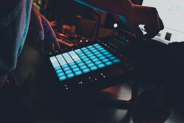 An electronic musician using a modern techno sample pack to elevate their music making skills.