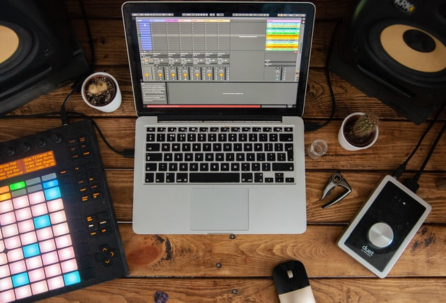 A laptop open with a techno sample pack being used to make best electronic music.