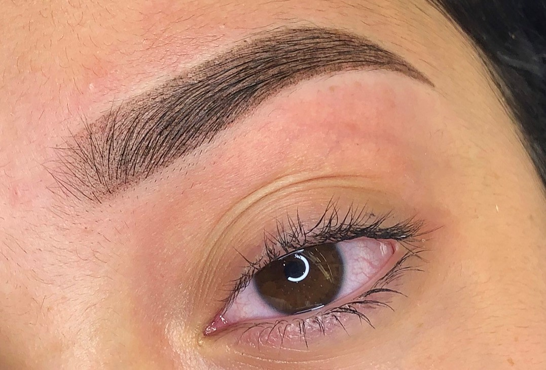 A woman with her dream powder ombre eyebrows.