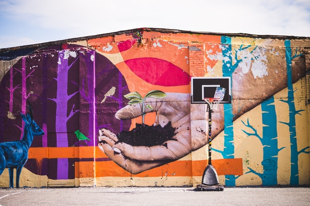A painting on a basketball court by a professional mural artist.